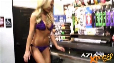 Part One - Sexy blonde, Mckenzee Miles, has fun on her bikini buying adventure.  Watch as she models the skimpiest bikinis and proceeds to tease the bikini salesman. from Aziani Xposed
