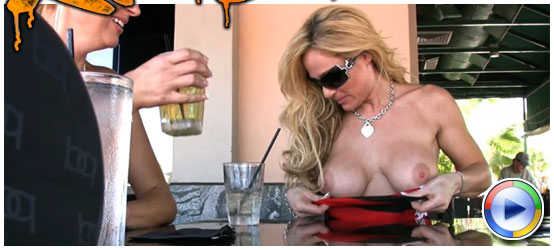 Tyler Faith's little tube top dress provides the perfect access for her to flash her big boobs, and expose her ever-hard nipples, while out at the bar having drinks! from Aziani Xposed